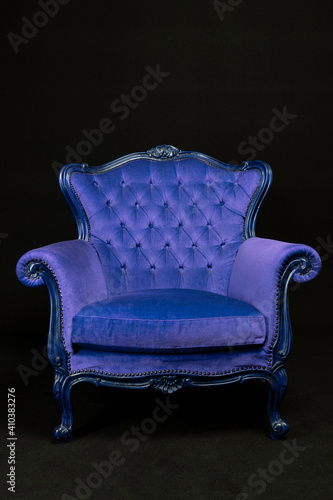 Fotografie, Obraz blue Isolated Bergère armchair on black background