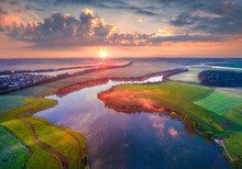 Exciting Summer View From Flying Drone Of Romanivka Lake. Impressive Morning Scene Of Ukrainian Countryside, Ternopil Region. Nice Sunrise On Ukraine, Europe. Traveling Concept Background.