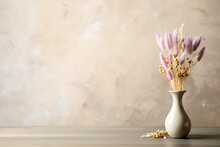 Dried Flowers In Vase On Table Against Light Grey Background. Space For Text