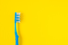 Blue Toothbrush On Yellow Background