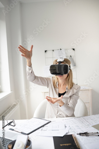 Fotografie, Obraz beautiful young female architect with virtual reality goggles is working in her