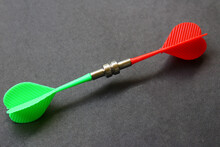 Magnetic Darts Attracted Towards Each Other