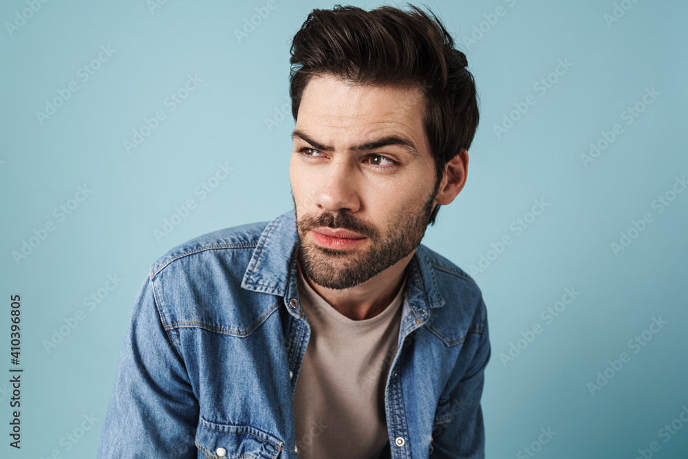 Fototapeta Young handsome brooding guy thinking and looking aside