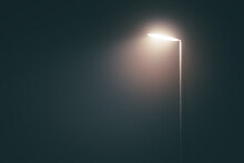 Streetlight Post With Bright Light In A Misty Fog