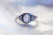 Antique Silver Ring With Rose Quartz Mineral Stone On White Shell Background