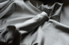 Erect Male Penis Under A Satin Cloth Blanket. Gift Vibrator Covered Chastely. The Usual Valentine's Gift And A Frequent Offer Of Sex Shops. The Greatness Of Male Nature Will Be Replaced By A Silicone