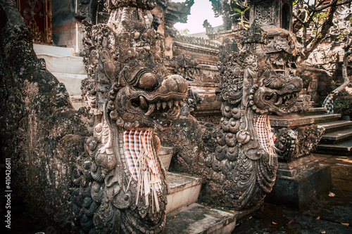 Fotografering Traditional Balinese sculpture at the entrance of a Hindu religious temple