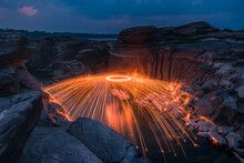 Burning Steel Wool On The Rock Near The River At Sam Phan Bok In Ubonratchathani Unseen In Thailand. The Grand Canyon Of Thailand.