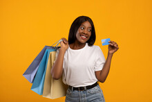 Cute Black Woman Shopaholic With Shopping Bags Recommending Credit Card