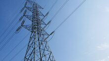 The Large High-voltage Transmission Towers Have A Complex Structure. With A Sky Background
