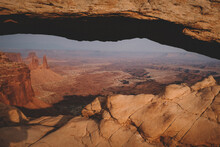Desert Landscape Through Mesa Arch In Canyonlands National Park.