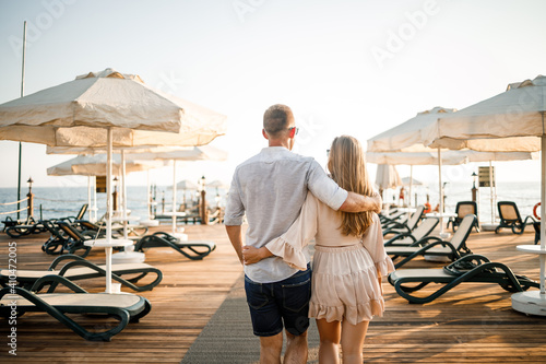 Fototapeta A loving couple is resting at the sea in Turkey