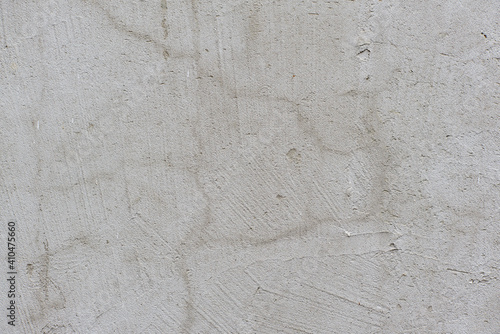 Grey texture of old broken asphalt road or wall big abrasions cracks holes on th Wallpaper Mural