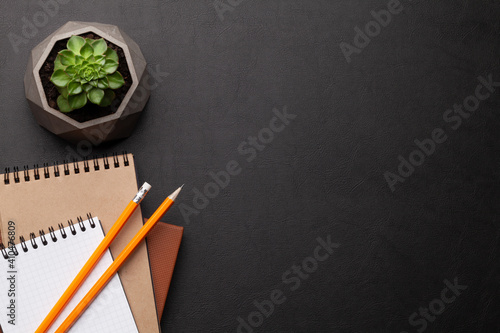 Obraz Office desk with supplies and potted plant - fototapety do salonu