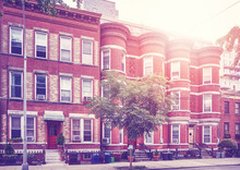 Retro Toned Picture Of Townhouses In Brooklyn New York, USA.