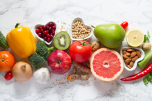 Healthy Food Selection: Fruits, Vegetables, Seeds, Nuts On Light Background
