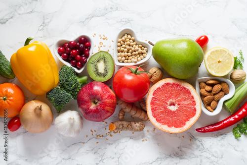 Fotografie, Obraz Healthy food selection: fruits, vegetables, seeds, nuts on light background