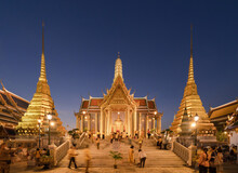 Golden Pagoda At Temple Of The Emerald Buddha In Bangkok, Thailand. Wat Phra Kaew And Grand Palace In Old Town, Urban City. Buddhist Temple, Thai Architecture. A Tourist Attraction At Night.