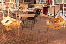 Wooden Swing Chair In The Coffee Shop For Two Person