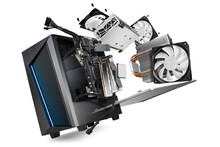 Flying Parts Of A Modern Computer. Hardware Components Mainboard Cpu Processor Graphic Card RAM Cables And Cooling Fan Flying Out Of Black Blue PC Case Isolated Abstract Technology Background