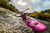 Whitewater kayaking, extreme sport rafting. Guy in kayak sails mountain river.