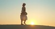 Attractive lady walking barefoot on sand in desert during safari