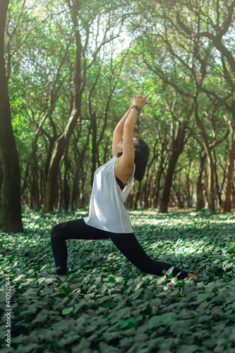 Healthy lifestyle for women practicing meditation and yoga in forest