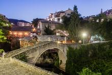 Evening View Of Kriva Cuprija (Crooked Bridge) In Mostar. Bosnia And Herzegovina