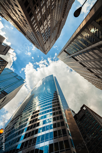 Fotografie, Obraz Upward view of modern skyscrapers in downtown Chicago, Illinois