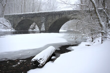 Bridge Over River In Winter