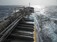 View From The Bridge Of A Ship Underway In Rough Sea. The Ship Is A Chemical Tanker With Many Pipelines Fitted Along The Deck. A Frammo Type Ship