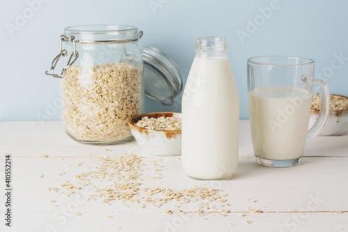 Vegan oat milk, non dairy alternative milk in a glass close up