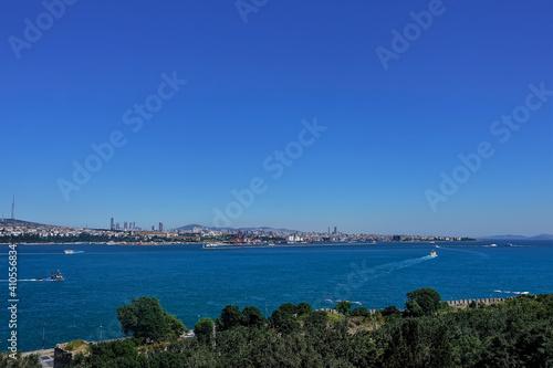 Fototapeta Ships sail on the blue surface of the Bosphorus
