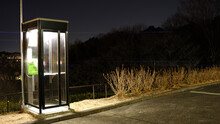 Tokyo,Japan-February 3, 2021: Isolated Telephone Booth In The Dark Of Night