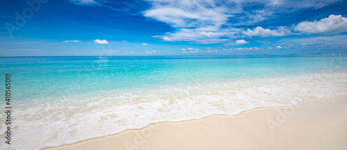 Obraz Closeup of sand on beach and blue summer sky. Panoramic beach landscape. Empty tropical beach and seascape. Blue sky, soft sand, calmness, tranquil relaxing sunlight, summer mood. Travel vacation - fototapety do salonu