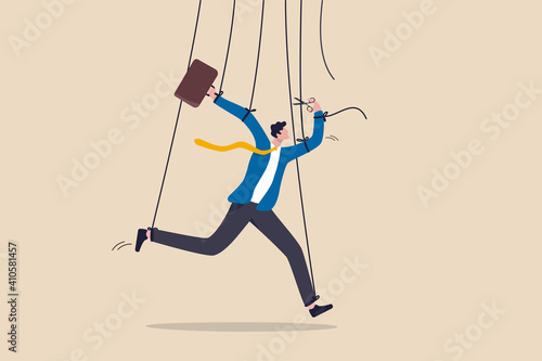 Freedom for work and decision making, authority to work independently, stop micromanagement, or people manipulation concept, businessman marionette, puppeteer use scissors to cut controlled strings Fotobehang