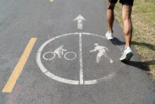 Closeup Of A Male Running On The Bicycle And Running Road Lane In San Francisco