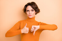 Photo Of Young Attractive Beautiful Unhappy Serious Girl Showing Thumb-up Thumb-down Isolated On Beige Color Background
