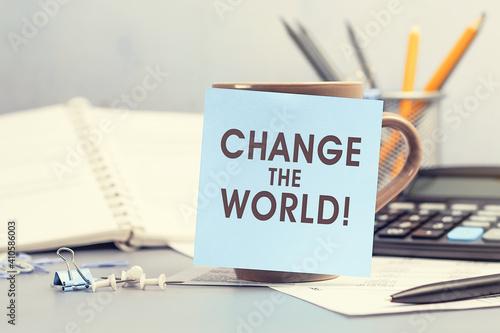 Obraz Change the world - concept of text on sticky note - fototapety do salonu