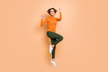 Full Size Photo Of Young Beautiful Smiling Cheerful Happy Smiling Girl Jump Raise Fists In Victory Isolated On Beige Color Background