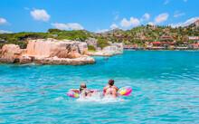 Girls In Bikini Lying On Air Bed - Kekova Island, Antalya Turkey