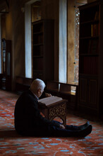 A Man Reciting Quran In Blue Mosque (Sultan Ahmed Mosque) Istanbul Turkey