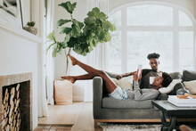 Cute Romantic Black Couple Reading A Book On The Couch