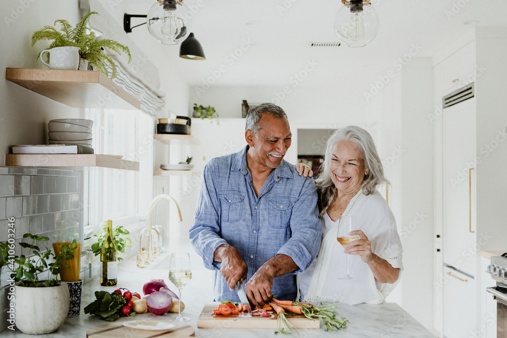 Fototapeta Elderly couple cooking in a kitchen