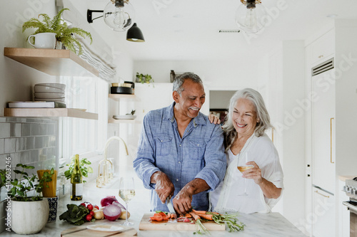 Obraz na plátně Elderly couple cooking in a kitchen