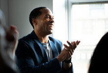 African American Man Clapping In A Seminar