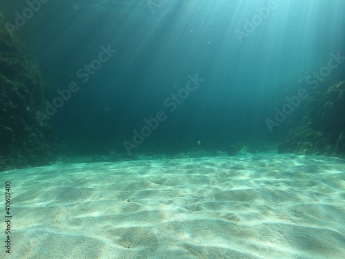Fotografie, Obraz underwater scene with rays of light on a beach on the island of Mallorca