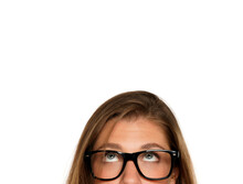 Half Portrait Of A Young Puzzled Woman With Eyeglasses