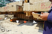 Engineers Are Recording The Subsidence Of Pile Foundation On The Form As Part Of The Dynamic Load Test By Using Large Cement Blocks To Press Down On The Pile.