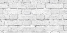 White Shabby Brick Wall Close-up Wide Texture. Light Grey Rough Old Brickwork Widescreen Background